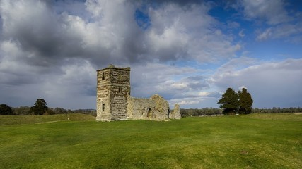 Clouds flow over the ancient ruins of a Mediaeval church