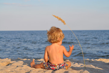 A child at the beach with spikelet