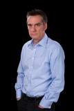 Angry Frowning Middle Age Business Man in Blue Shirt