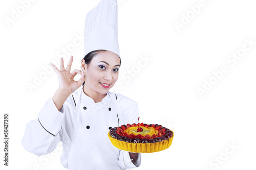 Beautiful chef serve delicious cake
