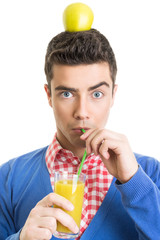 Funny nerd guy drinking fresh juice with straw
