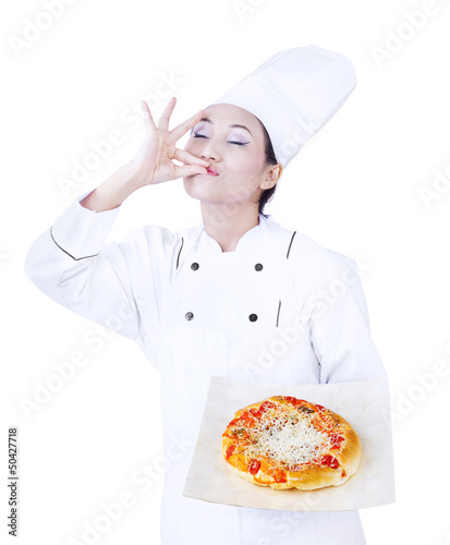 Delicious pizza hold by chef