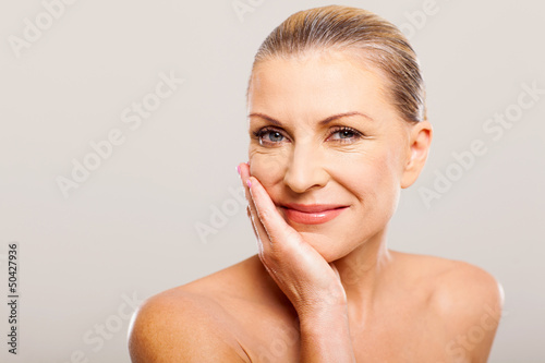 modern woman with hand on her face - 50427936