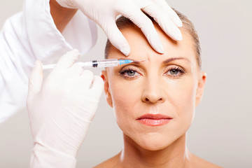 cosmetic surgeon giving face lifting injection