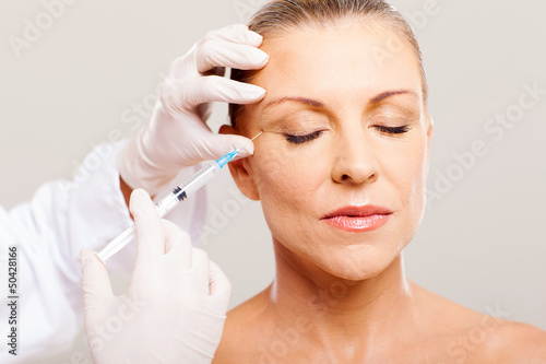 beautician giving face lifting injection - 50428166