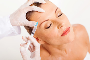 doctor giving face lifting injection