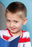 Closeup child boy with a book