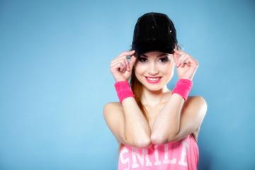 Sporty girl smiling in black baseball cap