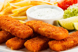 Fried fish fingers, French fries and vegetables