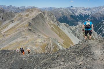 hikers descending alpine peak in Arthur's Pass