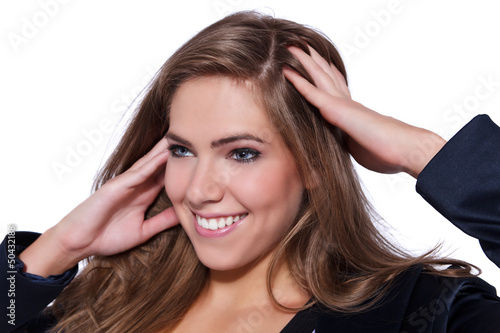 Portrait of a young beautiful woman massaging her head