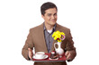 Man in suit holding tray with sweet breakfast