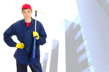 Young male window cleaner with wiper