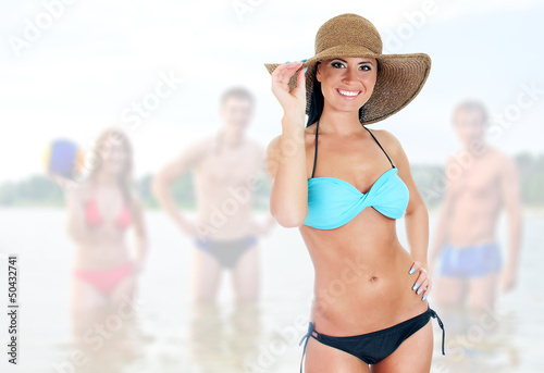 Pretty woman in bikini on sea landscape background