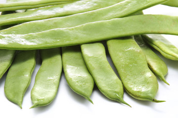 group of fresh green beans isolated on white