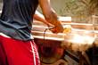 man using wood grinder.