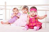 Baby girls in lovely dresses
