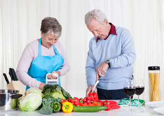 Senior Couple Cutting Vegetables