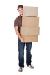 Portrait of delivery man with stack of boxes
