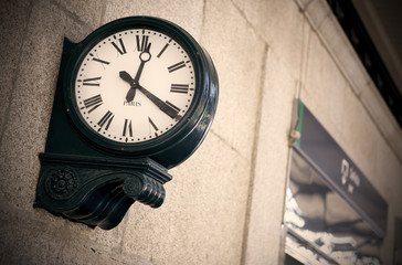 Outdoor analog clock in a railway station