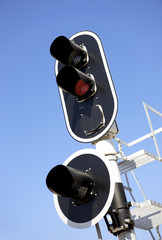Railway traffic lights on blue sky