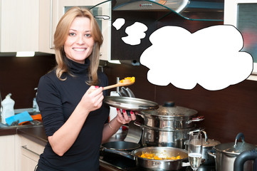 Attractive blond woman cooking in the kitchen with thought cloud