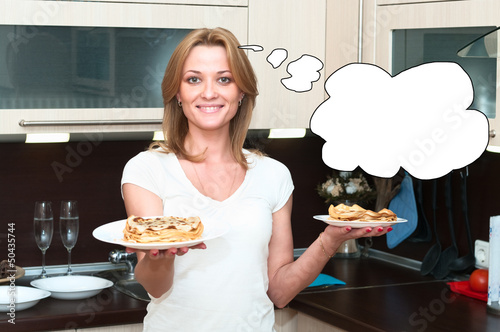 Beautiful happy smiling woman in kitchen interior. One person on