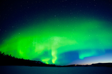 Intense display of Northern Lights at morning dawn