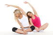 Sporty women do exercises. Fitness.