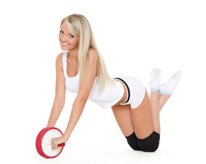 Sporty woman does exercises. Fitness..