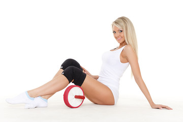 Sporty woman with roller slider. Fitness..