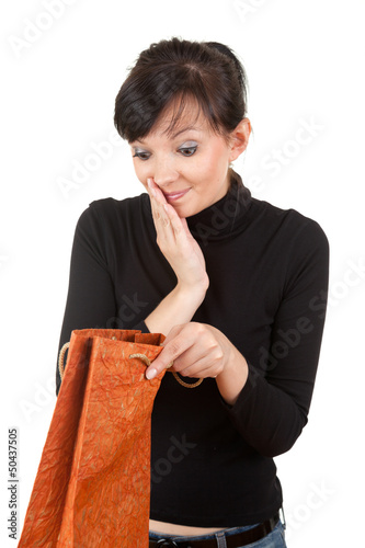 young woman with curiosity looking to present bag