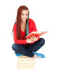 teenage girl with african plaits on stack of books, reading