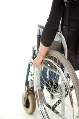 hands of a young woman sitting on a wheelchair