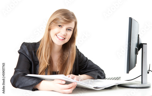 smiling businesswoman working with a computer