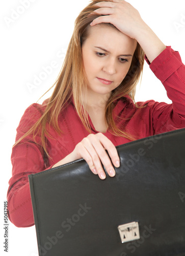 thoughtful young woman with briefcase