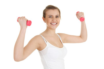 cheering teenage girl working out with small dumbbells