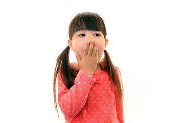 あくびをする女の子