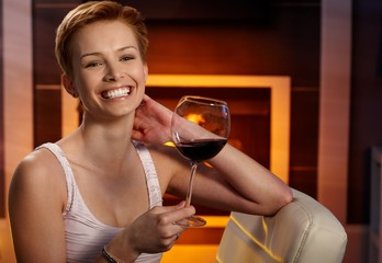 Happy woman with a glass of wine