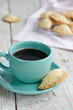 Cup of black coffee and fresh bakery