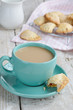Cup of coffee with milk and apple pies on wooden background