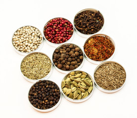 Nine types of spices in small bowls