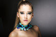 Luxury. Gorgeous Trendy Woman with Turquoise Necklace