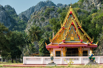 Buddhist temple and limestone rocks in Sam Roi Yot National Park