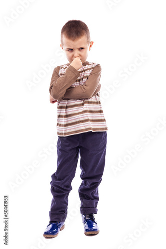 Portrait of a cute little boy thinking hard