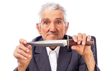 Portrait of an old man holding a knife and looking at camera