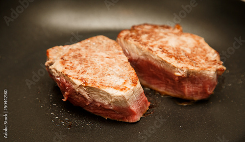 Two Fillets Sauteing in Pan