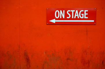 A Grungy 'On Stage' Sign Outside A Theatre Door