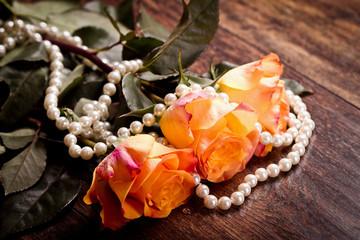 Orange roses in pearls