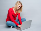 Young woman at laptop computer